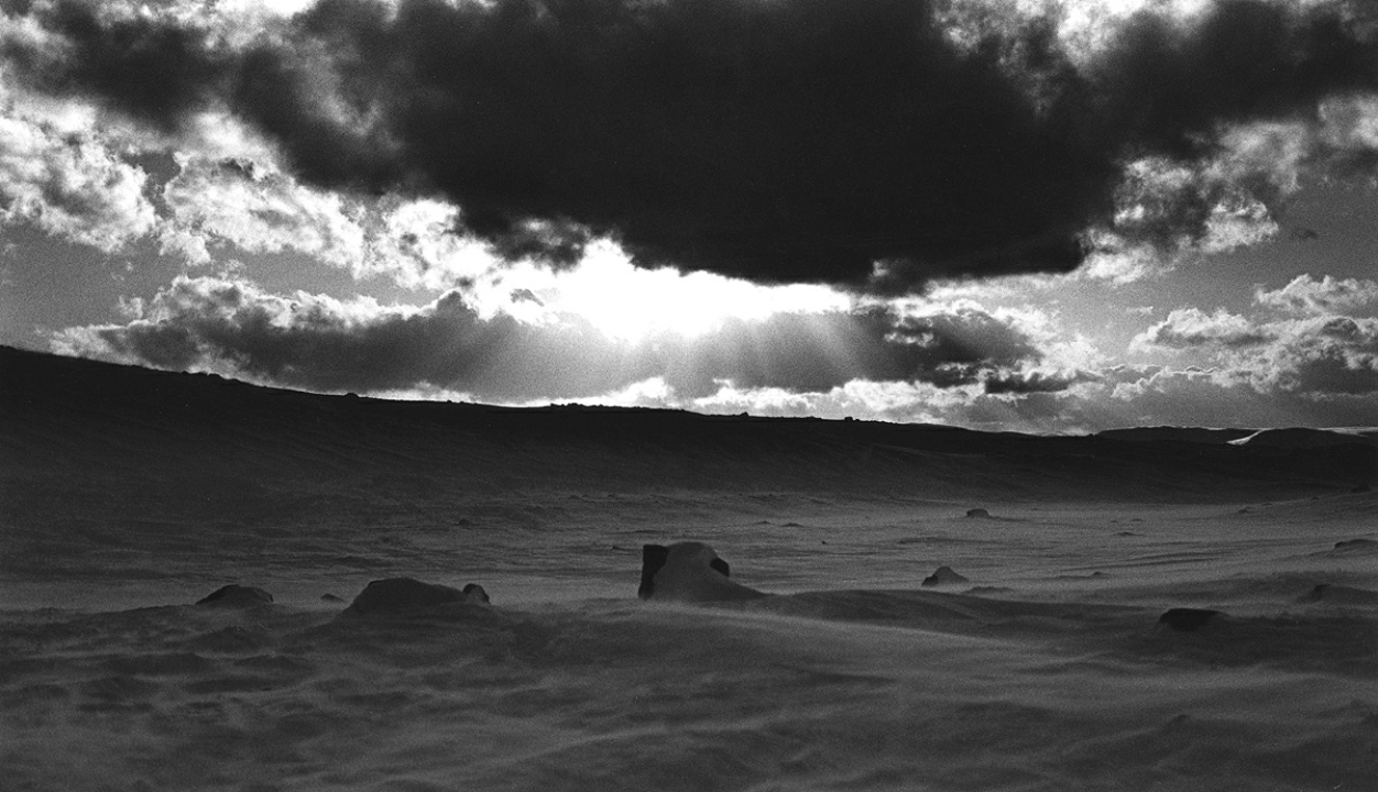 Wind blowing over frozen tundra area near Kilpisjärvi, in Käsivarsi wilderness area (analog B&W)